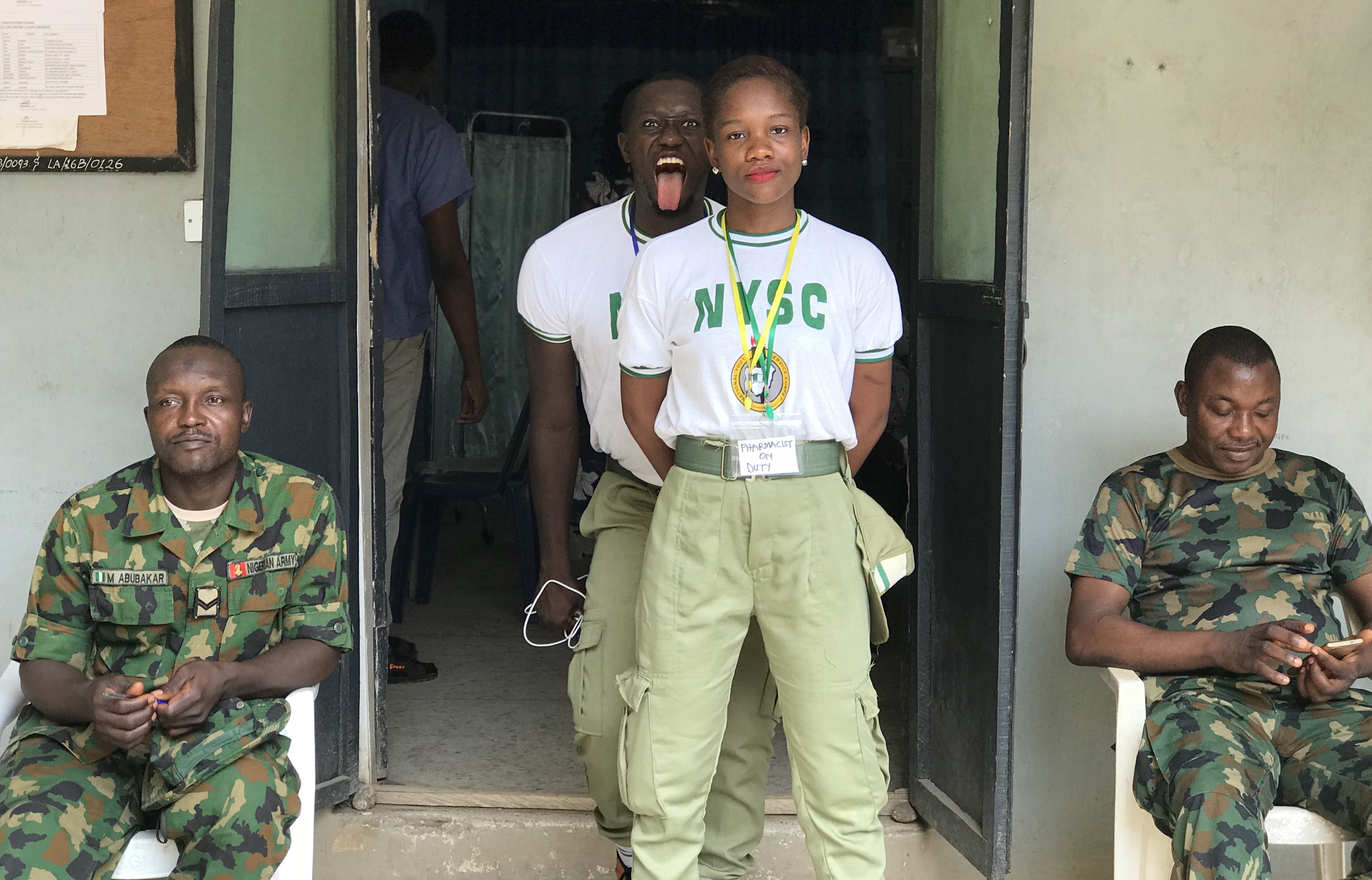 NYSC corps member with soldiers in Lagos camp